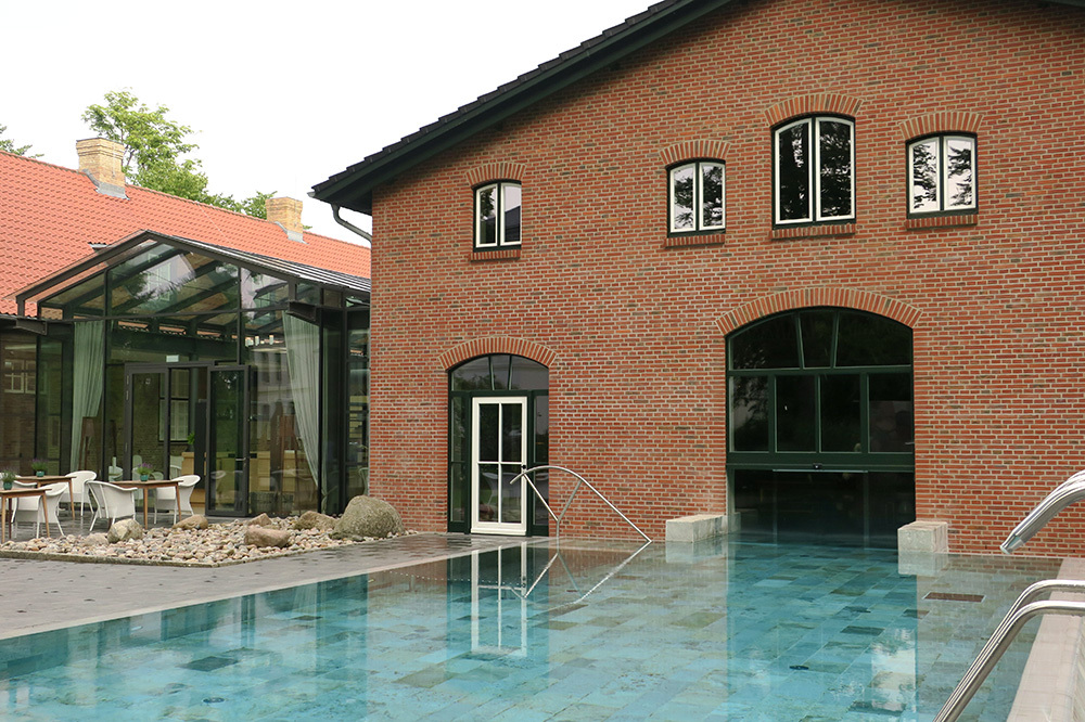 The outdoor section of the spa pool at Weissenhaus Grand Village Resort in Weissenhaus, Germany