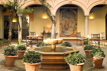 Spanish fountain in the courtyard at Parador de Granada in Andalusia, Spain