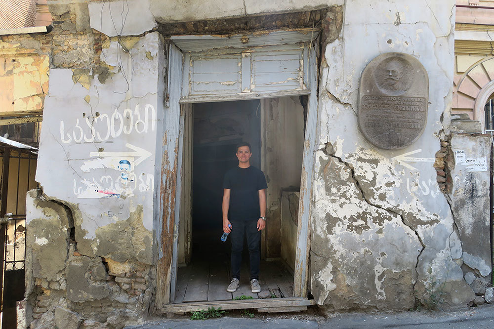 Our tour guide, Alexander, standing in the building where Tchaikovsky lived in Tbilisi, Georgia