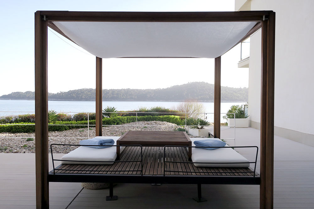 A daybed on the terrace by the pool at Villa Dubrovnik in Dubrovnik, Croatia