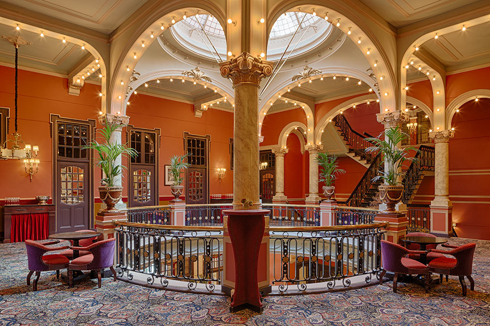 The Rotunda with table seating at Hotel Des Indes, a Luxury Collection Hotel in The Hague, Netherlands