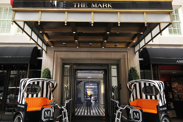 Main entrance flanked by hotel rickshaws at The Mark in Manhattan, New York