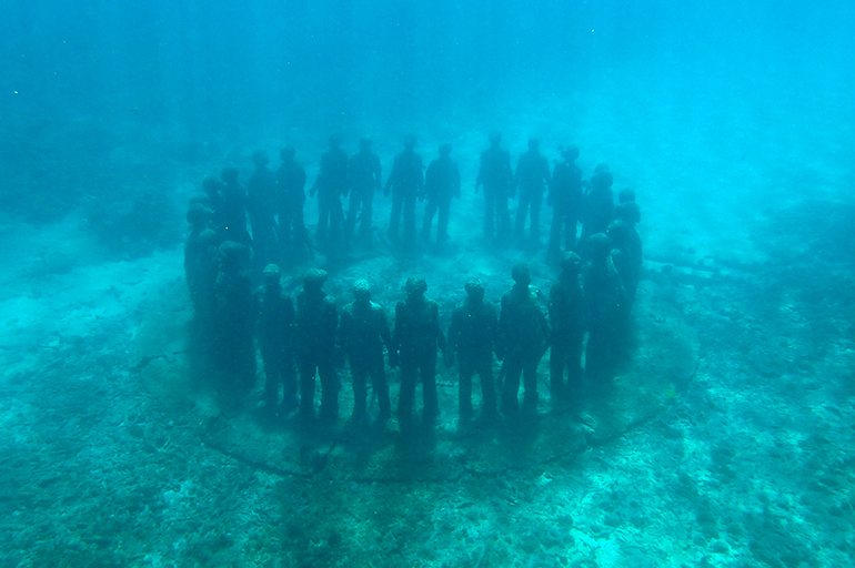 Underwater art installation seen while sailing with Savvy Tours in Grenada