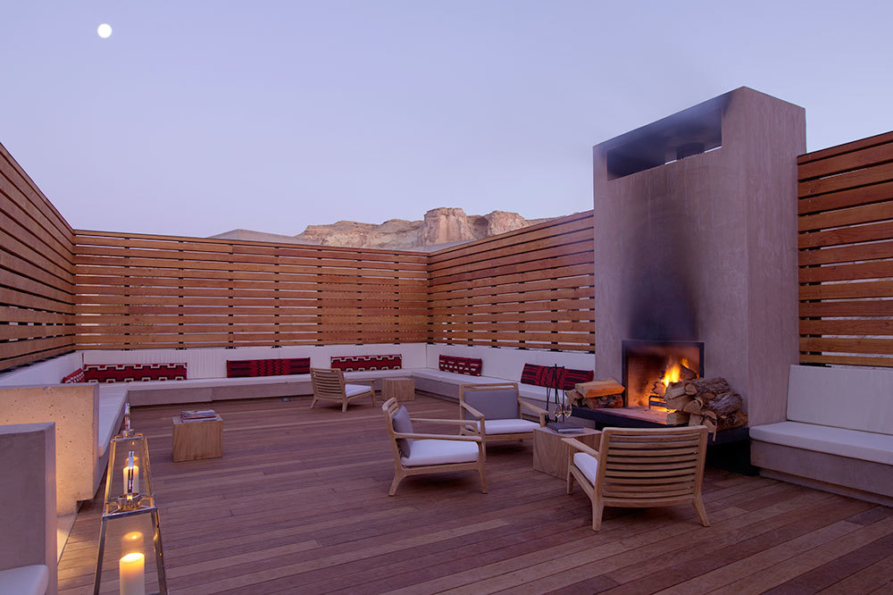 Storytelling Lounge with outdoor fireplace  at Amangiri in Canyon Point, Utah