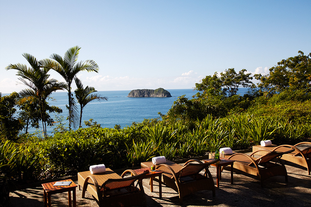 The view of the ocean from lounge chairs at Arenas del Mar Beachfront & Rainforest Resort in Quepos, Costa Rica