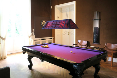 The billiards room in the château at Weissenhaus Grand Village Resort in Weissenhaus, Germany